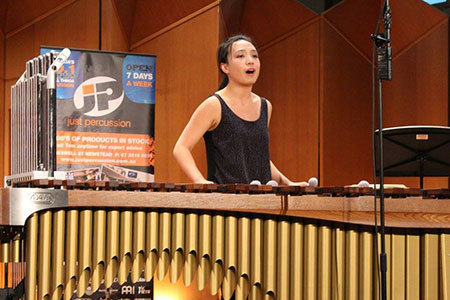 "Yun Ju Pan plays the marimba and singing piece ""Come Get Together"" in the final round of the competition."