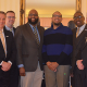 Blair Proctor and Justin Coles with representatives from TIAA at a reception in March, 2016.